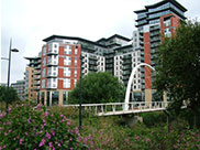 New buildings and a footbridge over the River Aire
