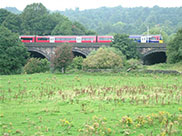 A train crosses the River Aire