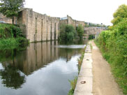 Stone-built canalside industrial buildings
